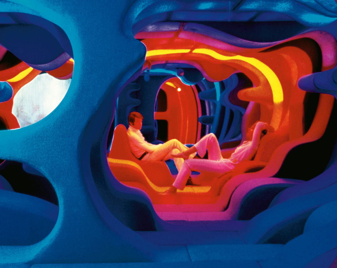 Visiona 2 (1970). A glimpse of Panton's renowned exhibition for the Bayer textile firm, presented at the furniture fair in Cologne in 1970. The most spectacular exhibit was a 48 m2 (517 sq ft) landscape, where the visitor was literally immersed in a sea of colours and undulating forms.