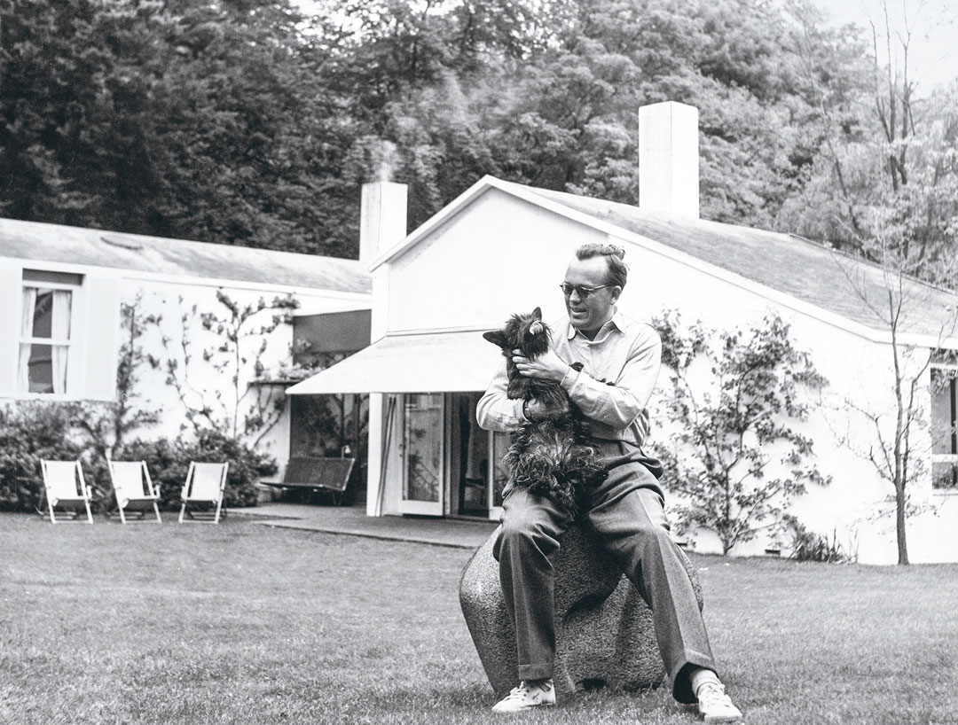 Juhl with the family dog, Bonnie, in the garden of his house at Kratvænget 15 in Ordrup, which he built himself in 1942.