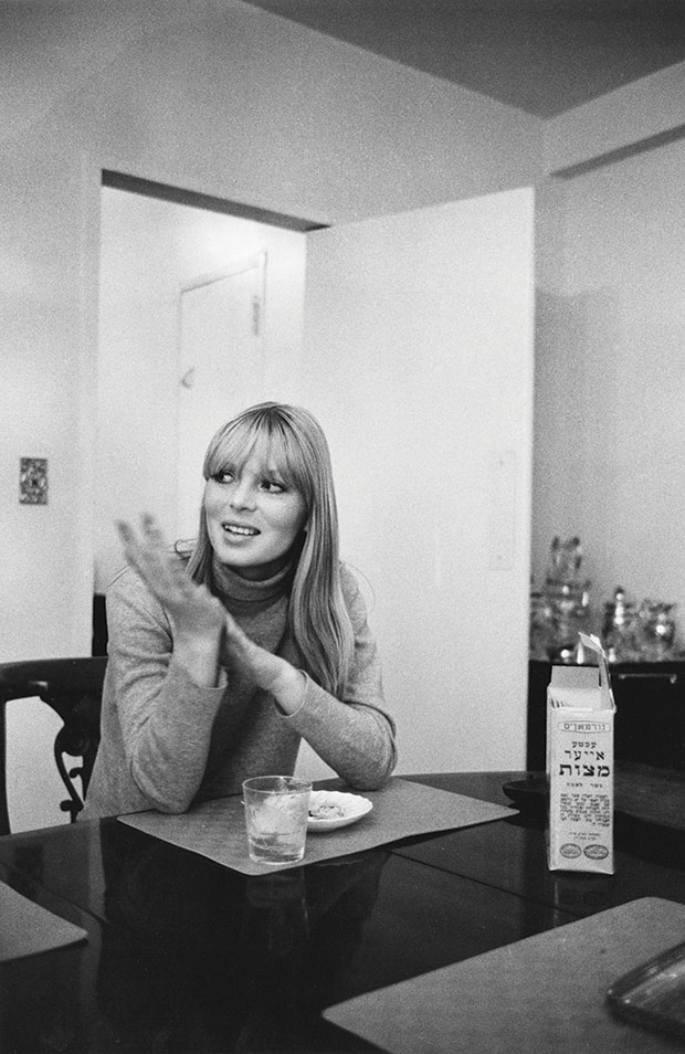 Nico (Christa Päffgen), actor, model, singer, Velvet Underground, in Shore's parents' dining room, with box of matzohs on table. From Factory Andy Warhol Stephen Shore
