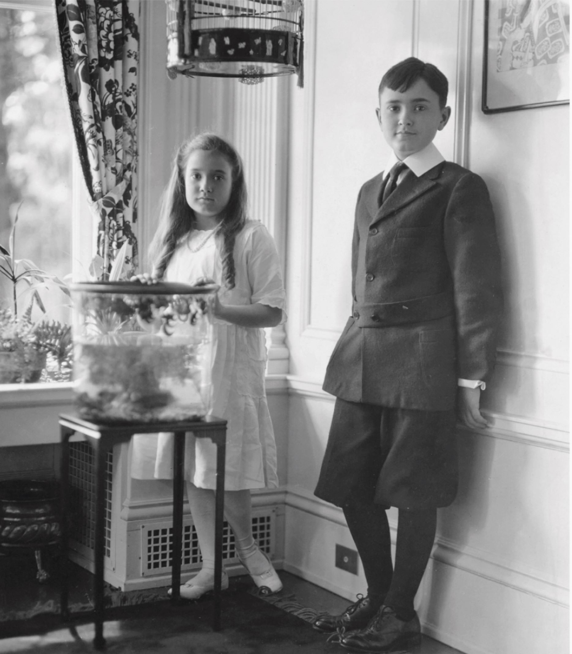 Portrait of Philip and his sister, Theodate, likely in their childhood home, New London, Ohio, as reproduced in Philip Johnson: A Visual Biography
