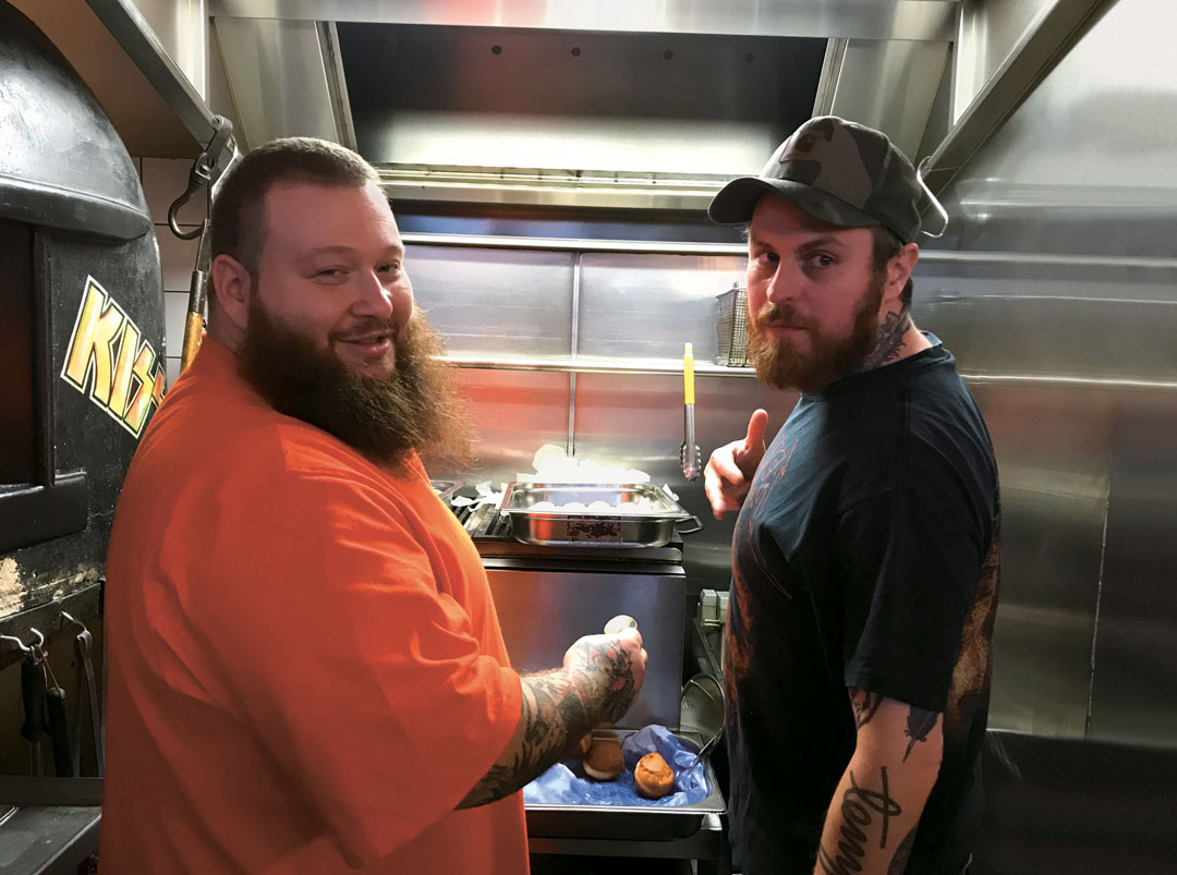 Lee Tiernan (right) with rapper and TV presenter Action Bronson