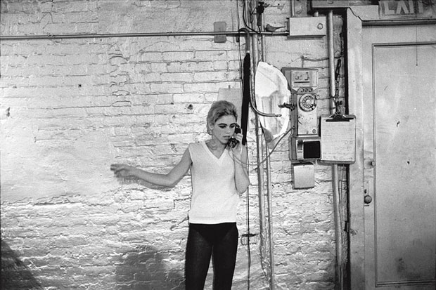 Edie Sedgwick using the only telephone in the Factory. From Factory Andy Warhol Stephen Shore.