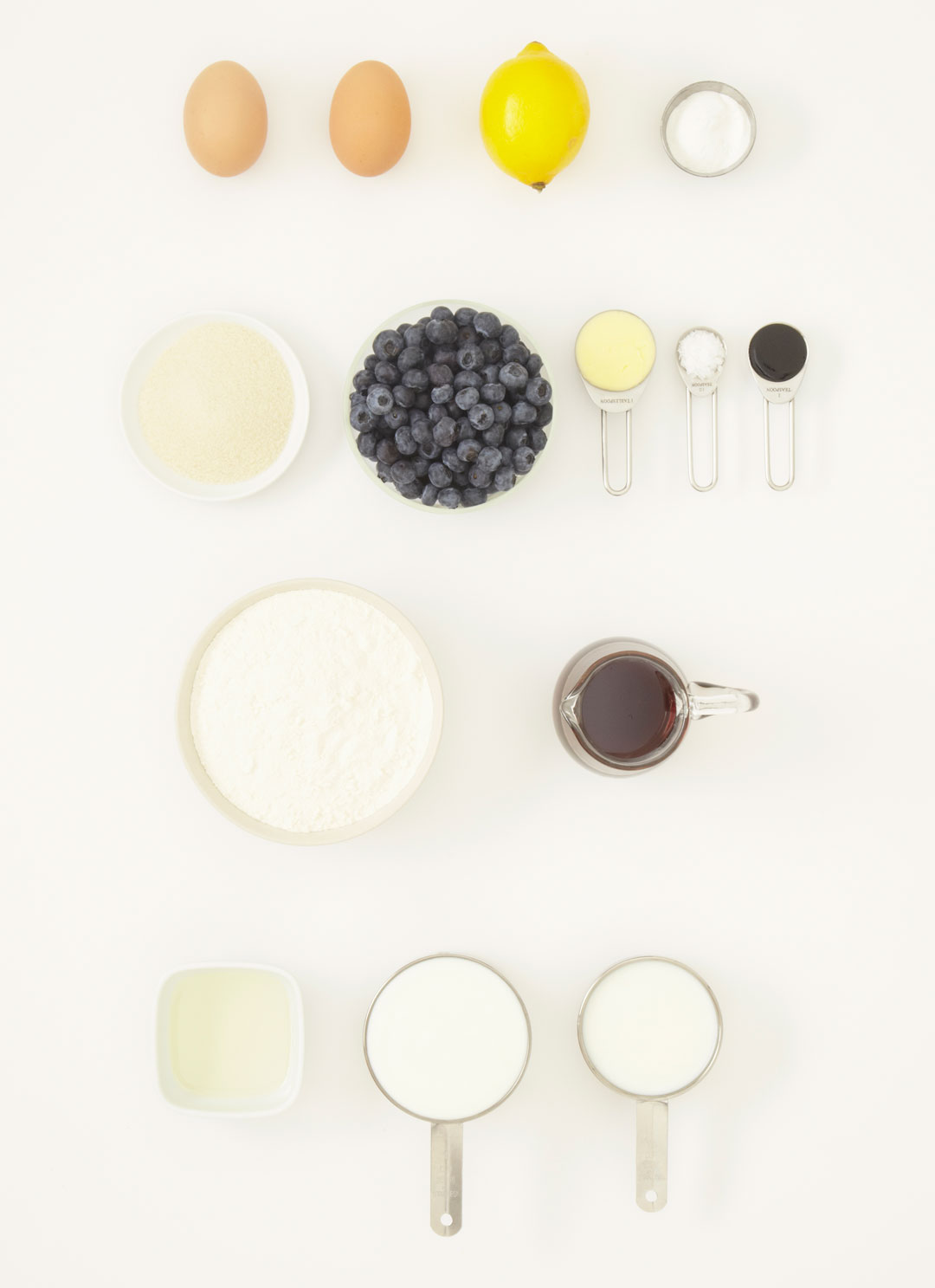 Ingredients for buttermilk pancakes with blueberries and syrup, as featured in Simple & Classic