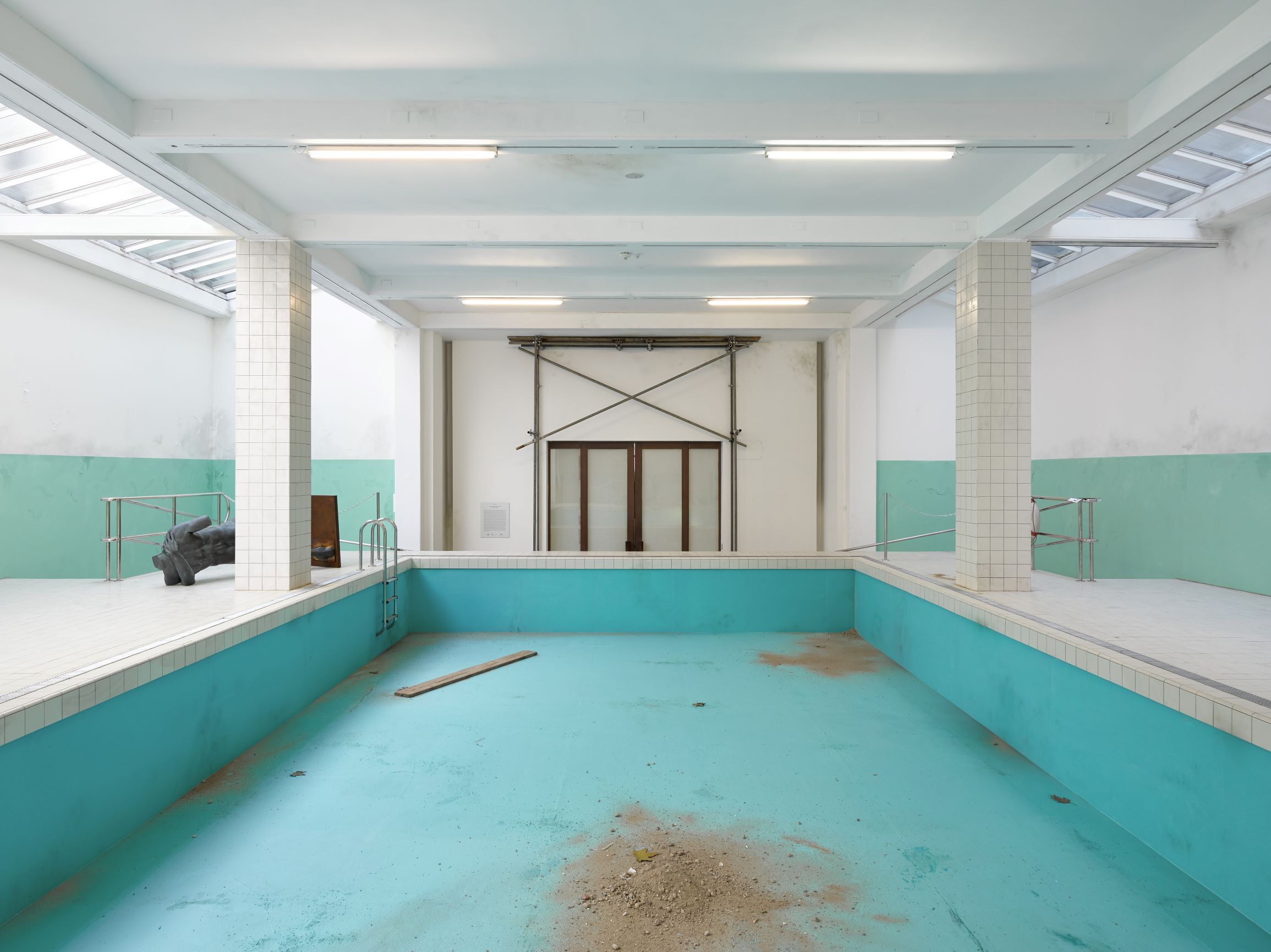 The Whitechapel Pool, 2018; wood, tiles, latex, polished stainless steel, linoleum, paint, 600 x 1450 x 2340 cm, installation view of 'This Is How We Bite Our Tongue', Whitechapel Gallery, London, 2018. Artwork © Elmgreen & Dragset