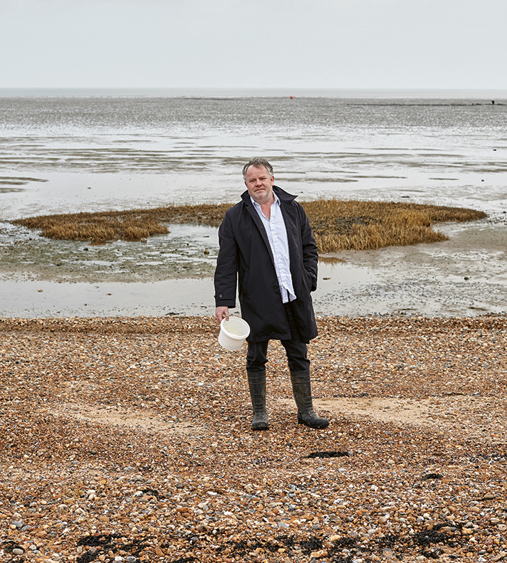 Chef Stephen Harris collects ingredients along the coastline beside The Sportsman. Photo: Toby Glanville