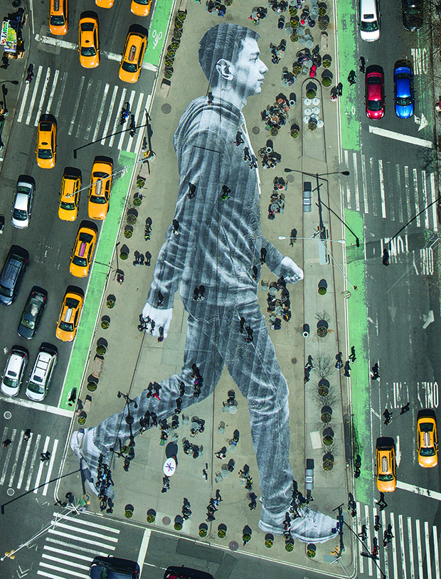 JR's huge street portrait of Elmar Aliyev, a 20-year-old waiter from Azerbaijan, which served as the New York Times Magazine's cover back in April 2015