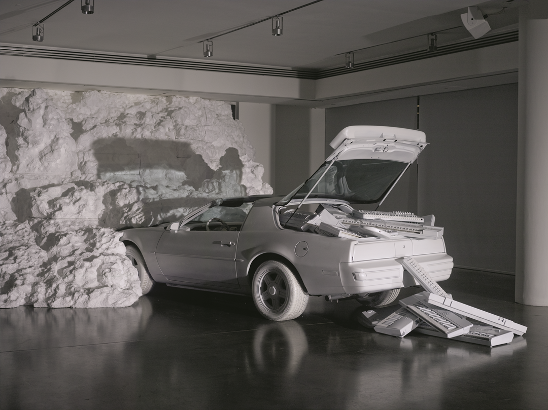 The White Room, 2013, EPS foam, custom matte white 1991 Pontiac Firebird, custom matte white instruments, 278.75m². Chromeo, New York, USA. Picture credit: photograph © Noah Kalina, courtesy of Snarkitecture
