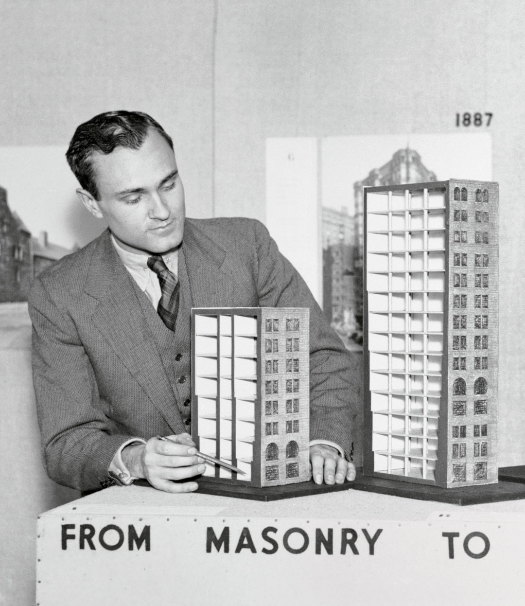 Philip Johnson with models demonstrating the evolution of the skyscraper from masonry to steel [detail]. Bettmann via Getty Images