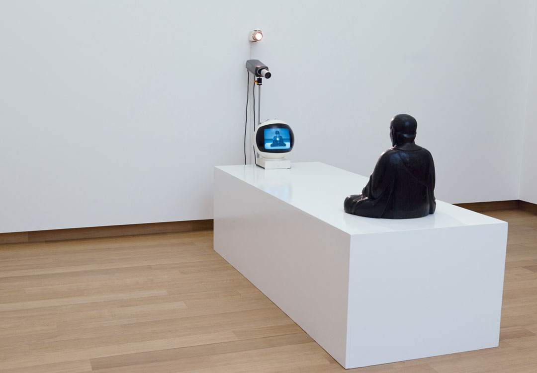 Nam June Paik, TV Buddha, 1974 Closed-circuit video installation, with eighteenth-century Buddha statue. As reproduced in Video/Art: The First Fifty Years