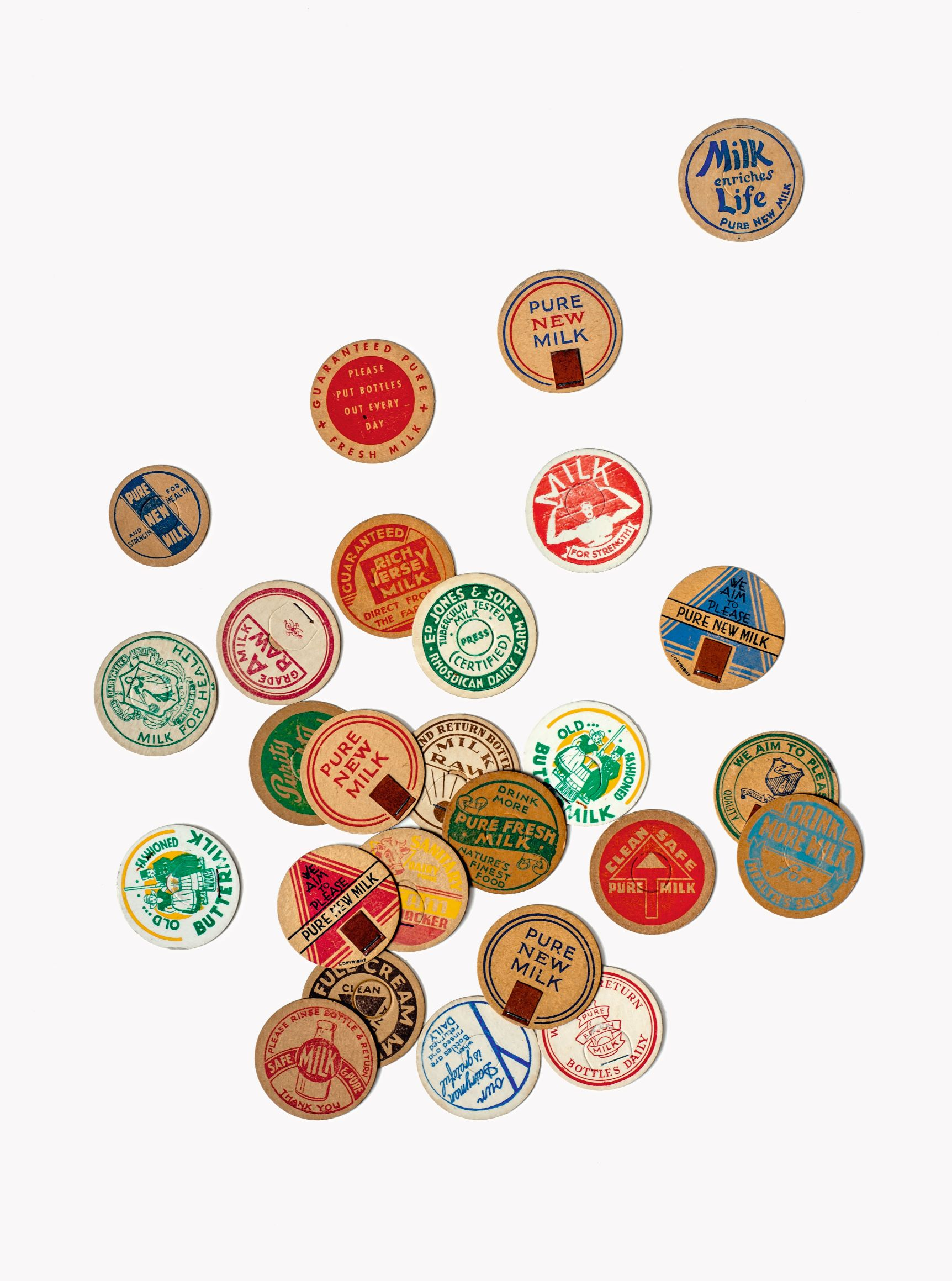 Milk-bottle Tops (England, 1950s), 1½ in. (3.8 cm) diameter, photograph by Flora Fricker, collection of Annie Atkins