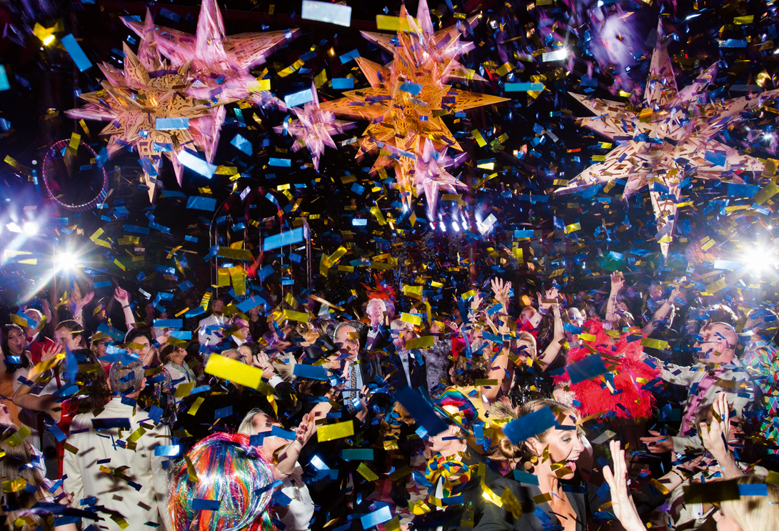 Confetti and guests explode on a dancefloor