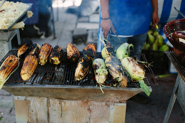 Barbecued corn stall, Mexico City. Photo by Araceli Paz. From Enrique Olvera's Mexico From the Inside Out
