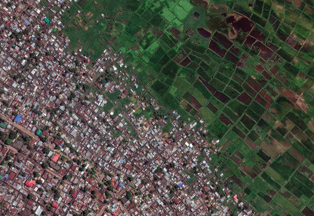 Kinshasa, Democratic Republic of Congo. In areas where land is cheap and unregulated, informal   development encroaches on the countryside that surrounds growing urban centres. As in many parts of rapidly urbanizing Sub-Saharan Africa, the edges of Kinshasa are being eroded as the city expands horizontally without regulation.