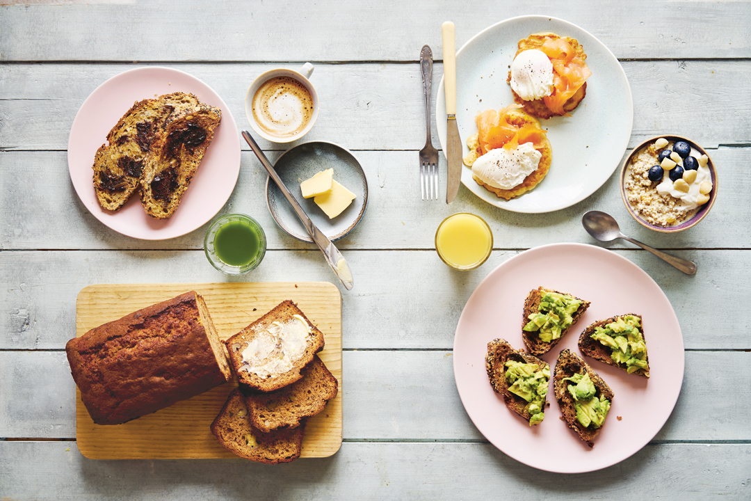 Clockwise From top left: toast with Vegemite; flat white; corn fritters with lox and poached eggs; muesli; ginger-turmeric juice; toast with Vegemite and avocado; banana bread; green juice. As featured on the Australian breakfast pages of Breakfast: The Cookbook