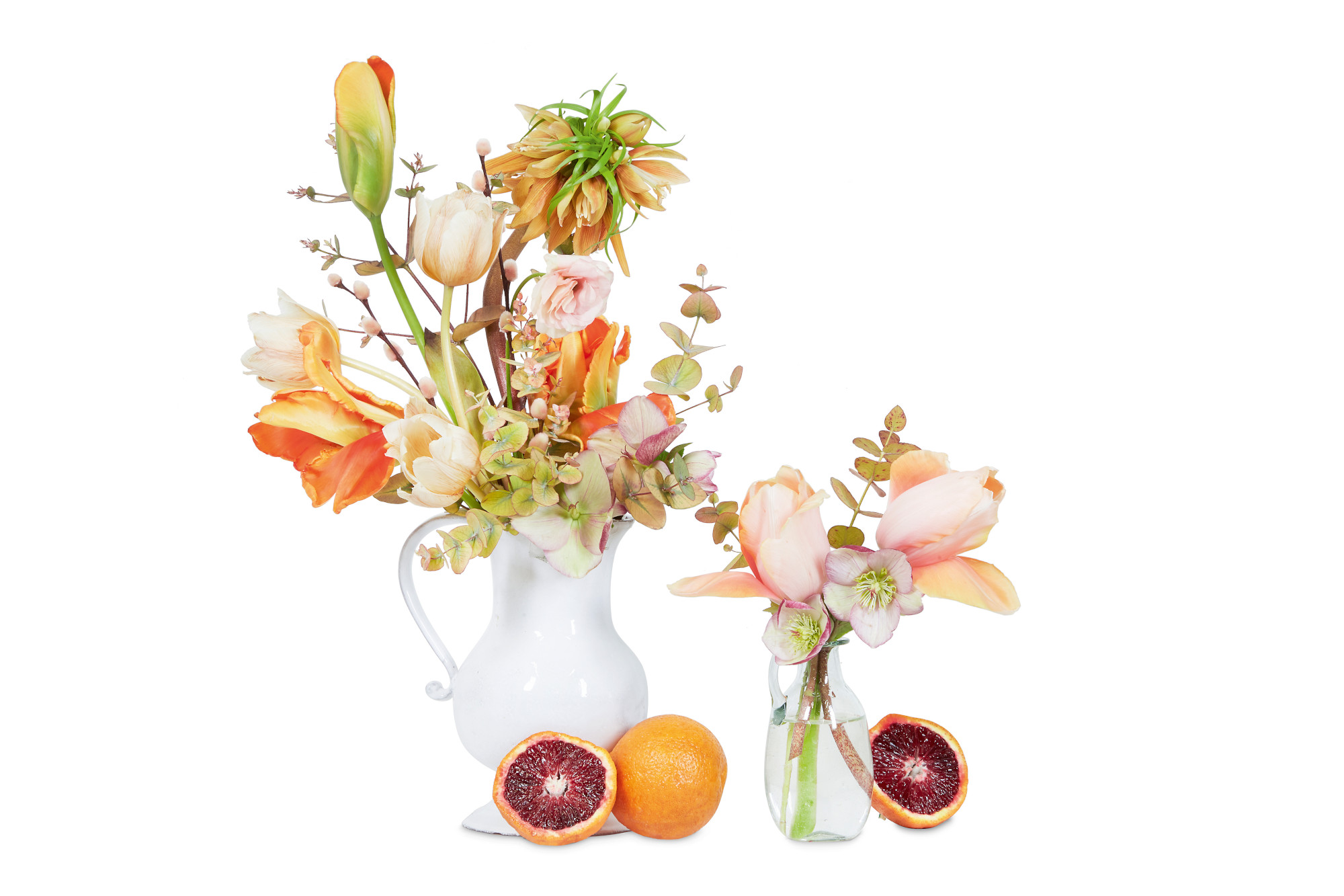 Accent Color: Orange, brown, and peach with burgundy accent. Crown imperial fritillary, Tulip, Blood orange, Ranunculus, Eucalyptus, Pussy willow. Employing vessels made of different materials, like glass and ceramic here, adds texture to a composition