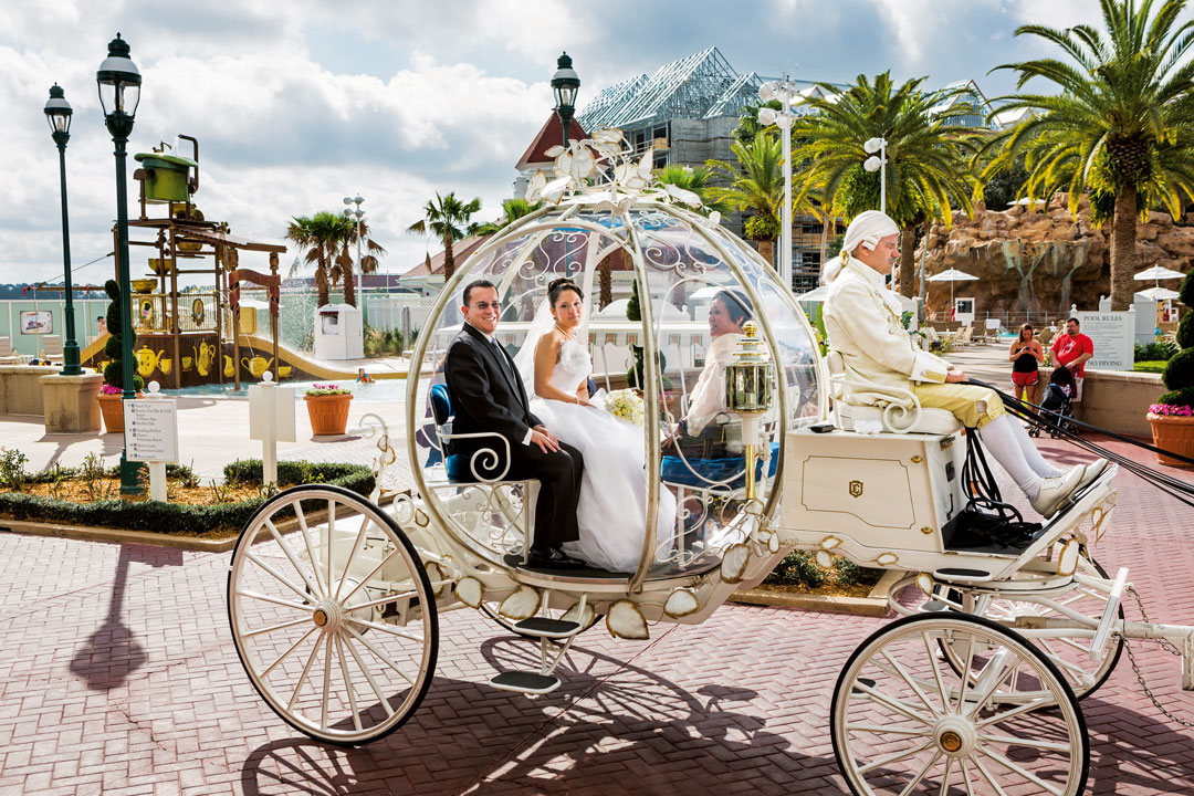Christina, 21, a Walmart pharmacy technician, en route to her wedding in Cinderella's glass coach, drawn by six miniature white ponies and with bewigged coachman, Walt Disney World, Orlando, Florida, 2013. From Generation Wealth by Lauren Greenfield