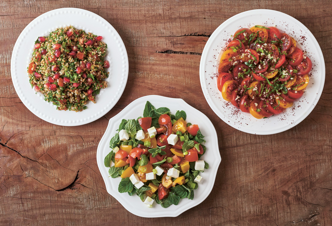 Salads, Sides, and Vegetables: from left: Teta Asma's Tabuleh; Za'atar Salad; Tomato, Garlic and Sumac Salad