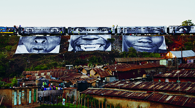 Women are Heroes: Train passing, Kibera, Kenya, 2009. From JR: Can Art Change the World