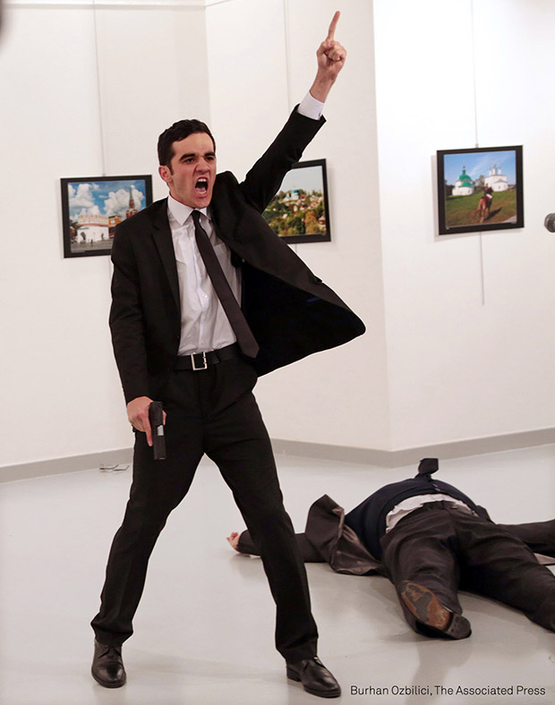 World Press Photo of the Year 2017. Mevlüt Mert Altıntaş shouts after shooting Andrey Karlov, the Russian ambassador to Turkey, at an art gallery in Ankara, Turkey. © Burhan Ozbilici, The Associated Press Title: An Assassination in Turkey
