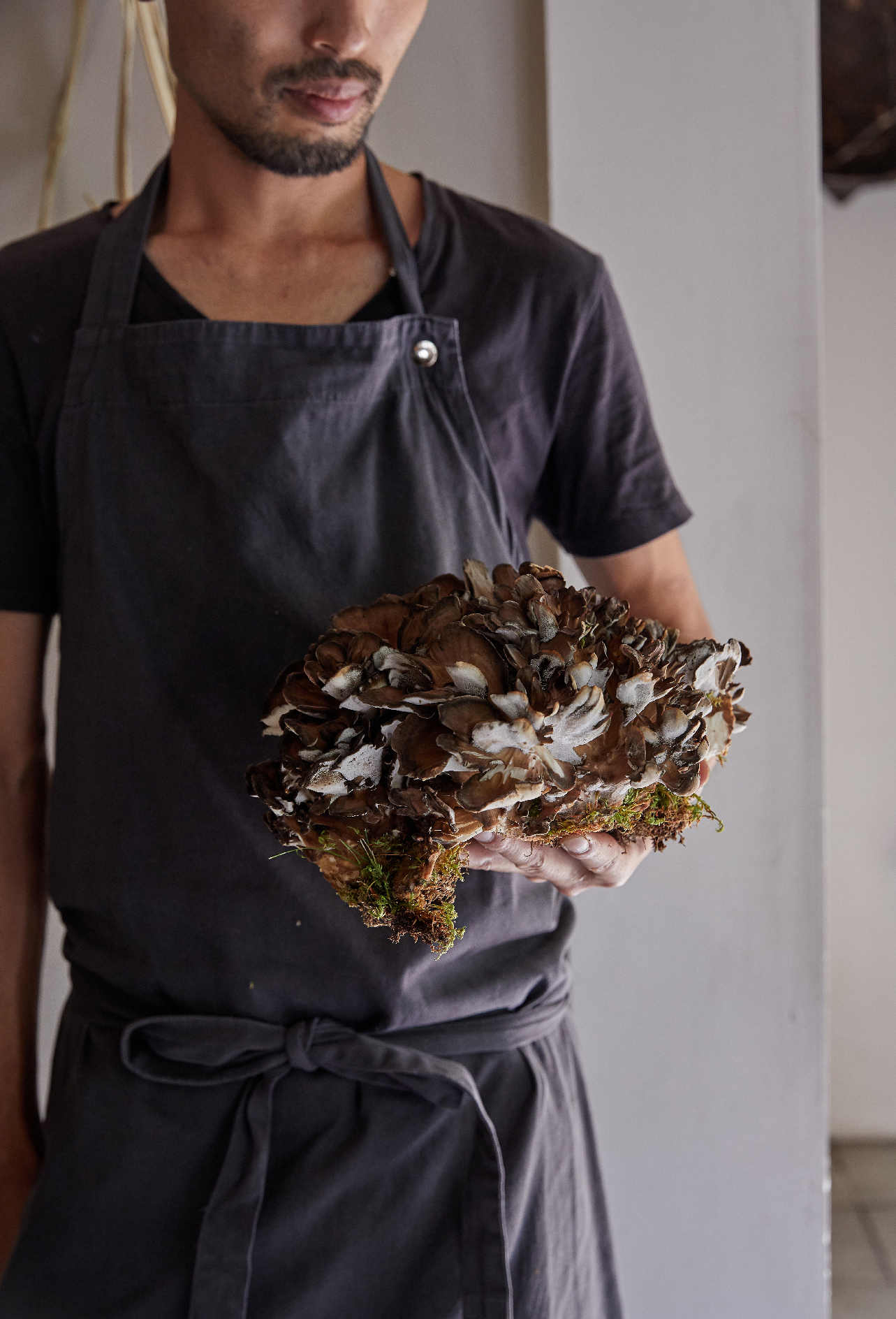 Yoshihiro Imai with a maitake mushroom, from monk. All photographs by Yuka Yanazume