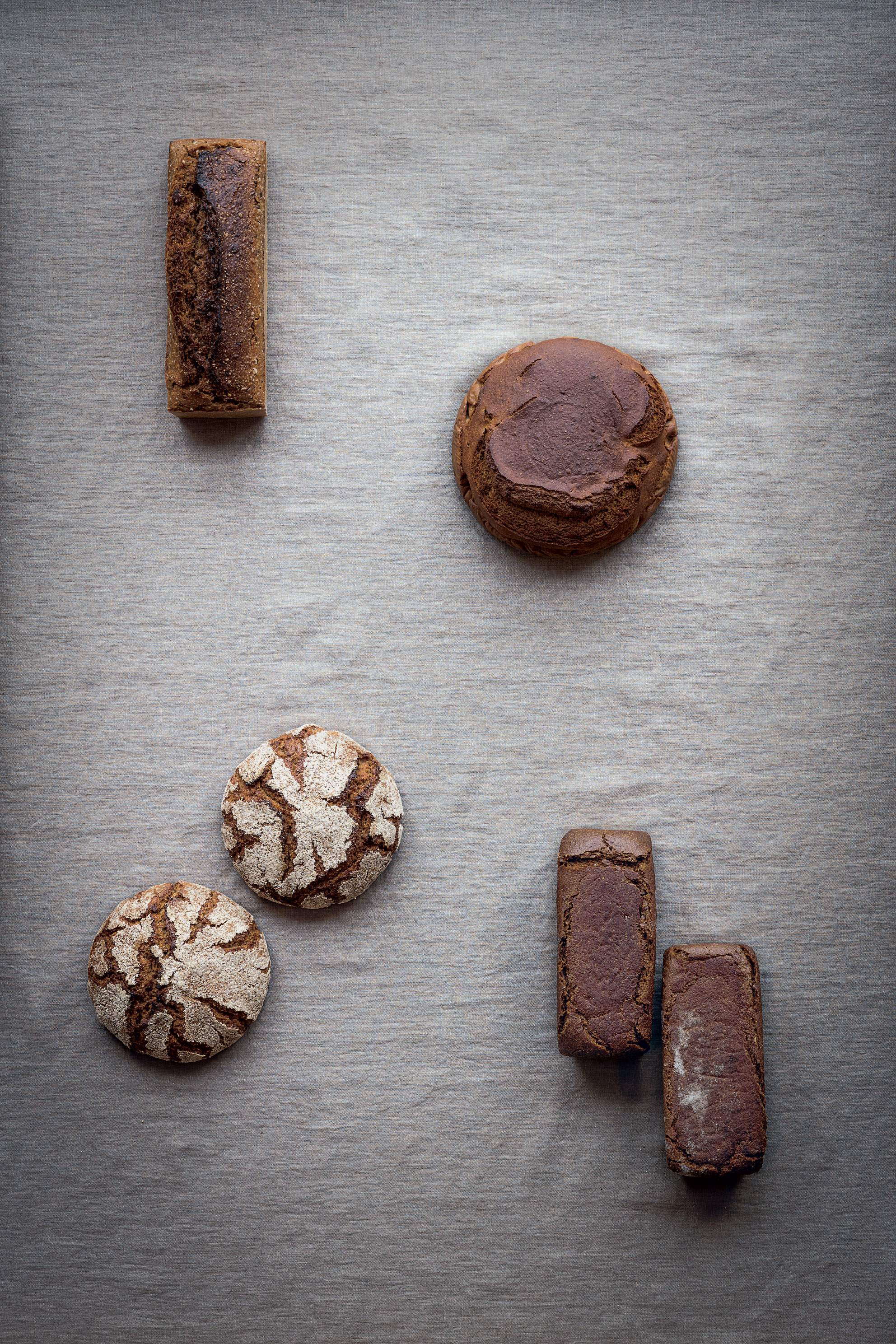 Icelandic rye bread (top right), alongside other rye loaves from Denmark (top left), Scania, southern Sweden (bottom right) and Finland (bottom left)