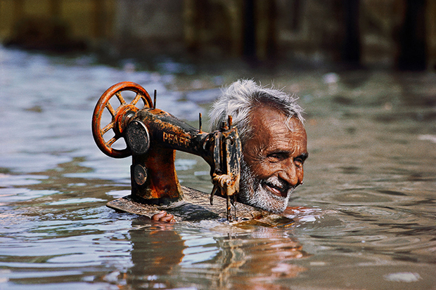 Tailor carrying his sewing machine, Porbandar, India, 1983. From Steve McCurry Untold