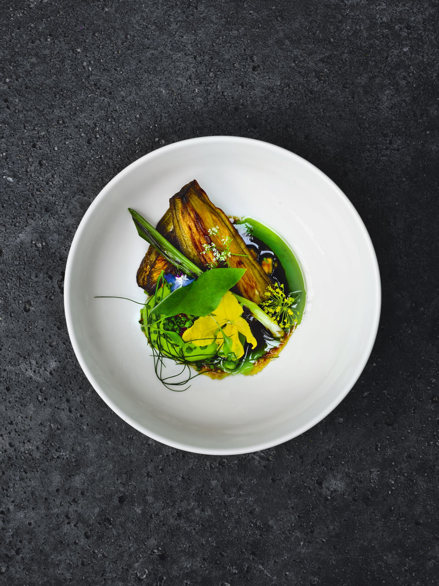 Barbecued eggplant, with peanut vinaigrette, green curry and herbs