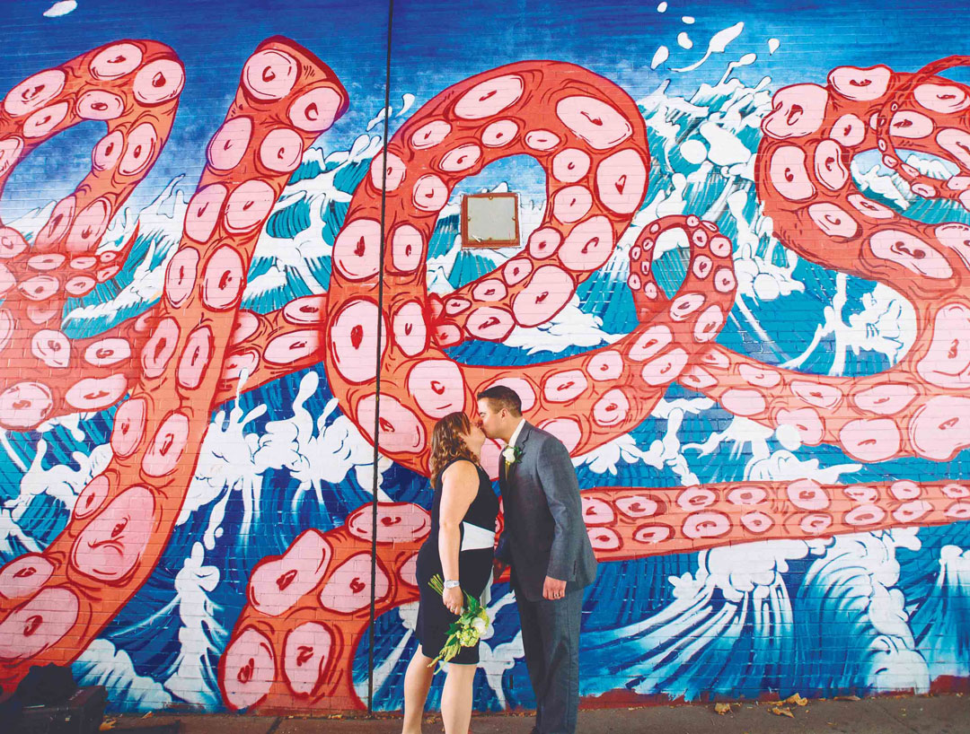 A neglected underpass below the Brooklyn-Queens Expressway, since decorated by Sagmeister & Walsh with the word YES on either side, being used by newlyweds as a backdrop for wedding photos. Picture credit: © Pop! Wed Co.