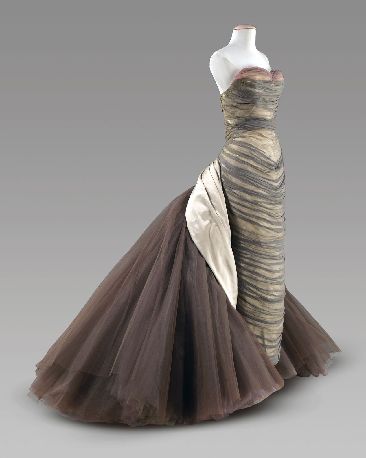 You love the 'Butterfly' (p.167, fig.7) by Charles James, a designer you're less familiar with than Dior or Chanel, and you follow the essay cross-reference in the expectation of learning more about him. From Art =