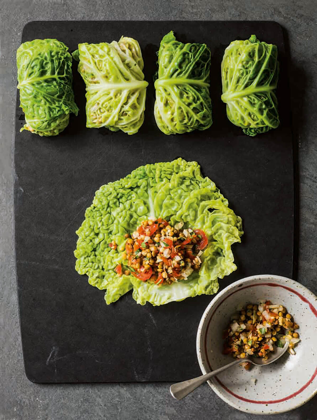 Stuffed cabbage leaves baked in tomato sauce, from The Middle Eastern Vegetarian Cookbook