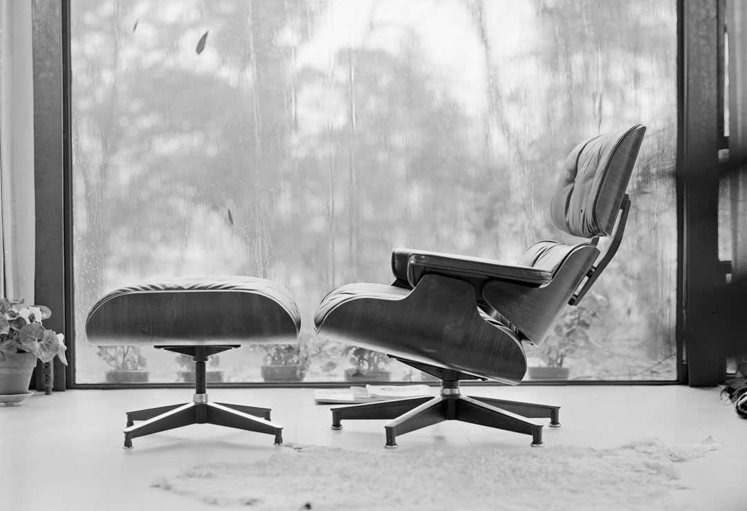 670 chair and 671 ottoman within the Eames House, photographed by Charles and Ray Eames, c. 1956. As reproduced in our new Herman Miller book