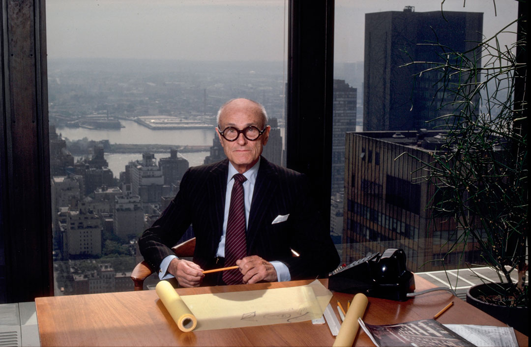 Portrait of Philip at his desk in his New York office in the Seagram Building, 1982.
