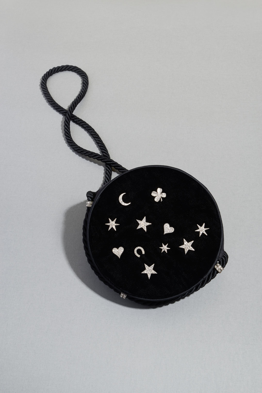 Black velvet tambourine bag with diamanté charms and a black cord strap (made by Renaud), about 1970. Photo by Lavanchy Matthieu