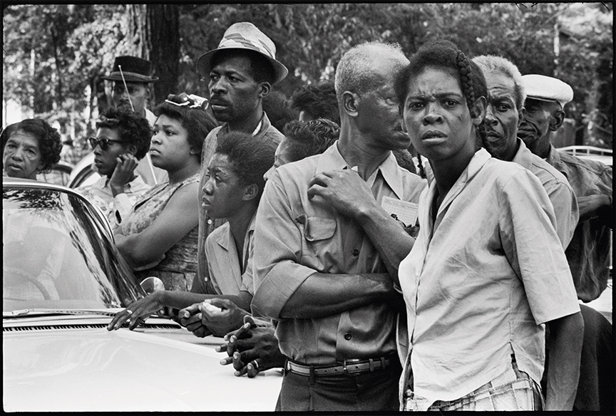 Crowds along the funeral route of the four girls murdered in the bombing of the 16th Street Baptist church, Birmingham, Alabama, September 1963 / Student Non-violent Coordinating Committee (SNCC), 1964–62. All photographs by Danny Lyon, from The Seventh Dog