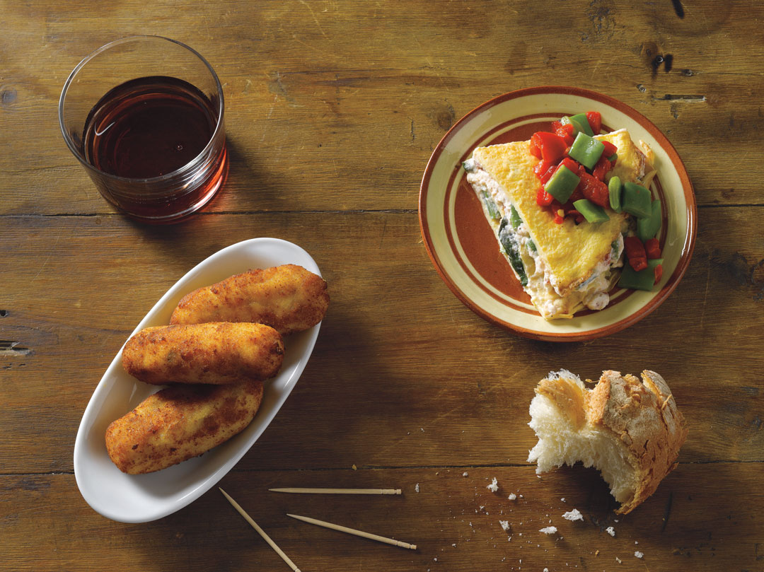 Cheese and egg croquettes and tortilla 'cake' with cheese and beans