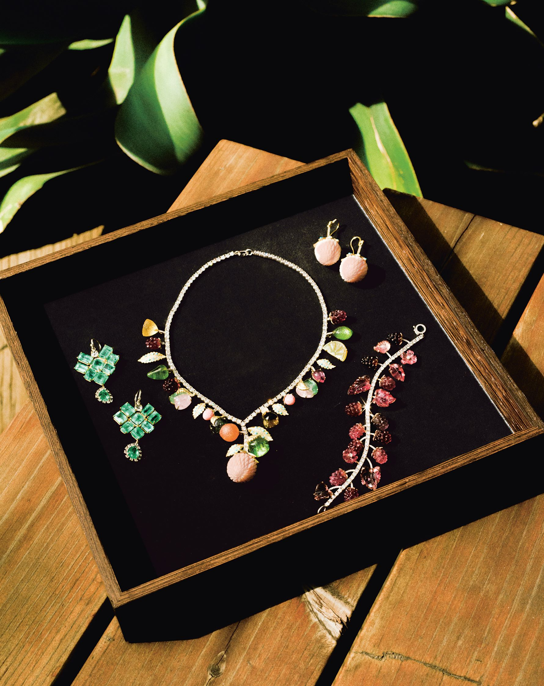 Irene Neuwirth's Green Emerald Diamond Gold Double Drop Earrings with One of a Kind Fruit Punch Diamond Necklace, Carved Opal Strawberry Earrings, and One of a Kind Pink Tourmaline and Diamond Raspberry bracelet. Photo by Chantal Anderson