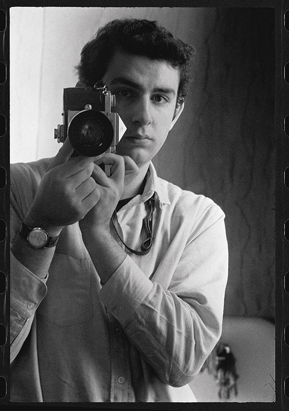 Self-portrait with my Nikon F Reflex / University of Chicago, 1960
