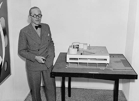 Le Corbusier with his model for Villa Savoye, 1928