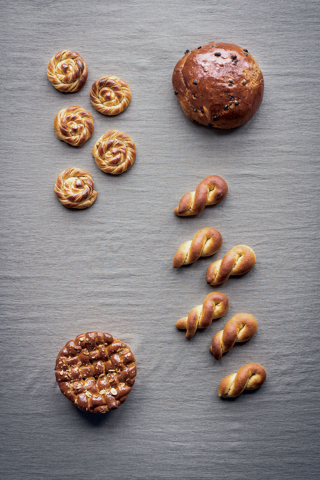 Clockwise from top left: Karlsbader Buns with Almond Paste Filling; Norwegian Christmas Bread; Boys; Danish Almond Tart Leavened with Yeast. All images by Magnus Nilsson from The Nordic Baking Book