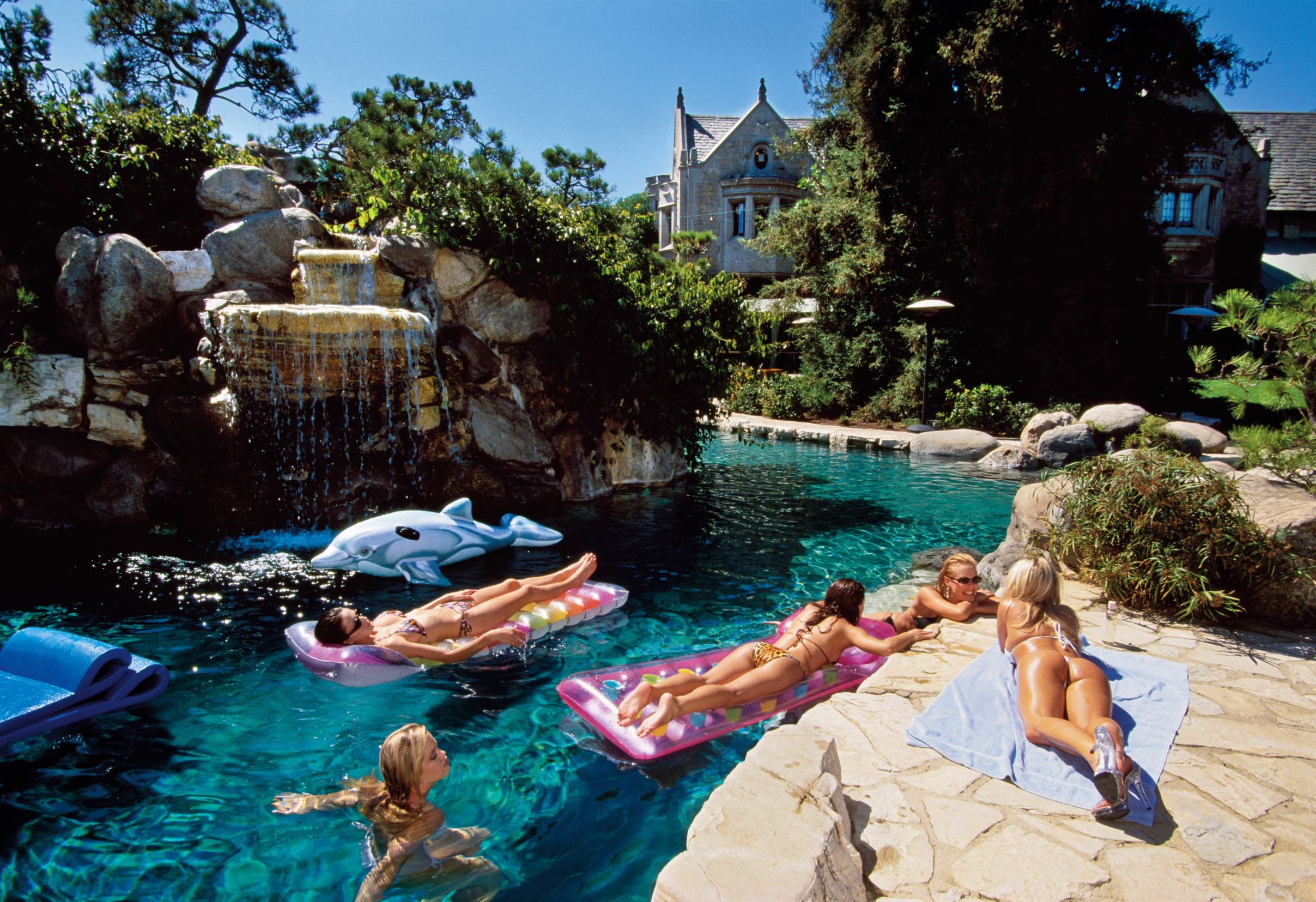 Playmates at the Playboy Mansion's grotto, Holmby Hills, Los Angeles, 2000, by Lauren Greenfield