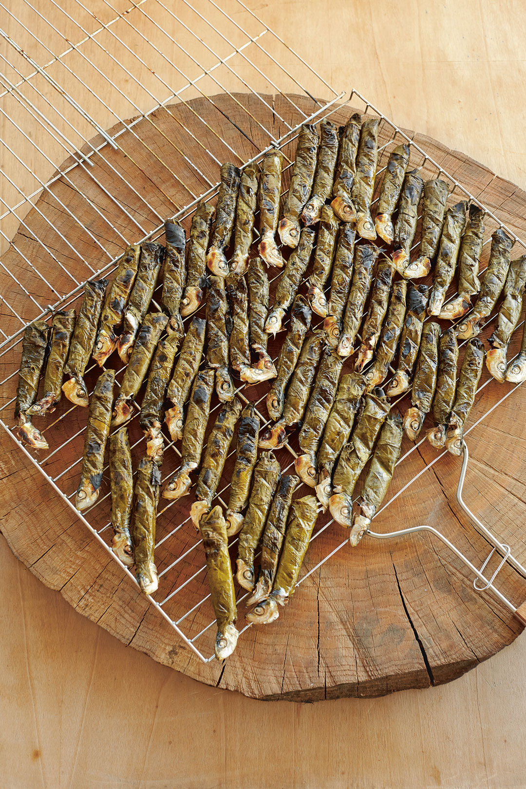 Sardines grilled in vine leaves, from The Turkish Cookbook