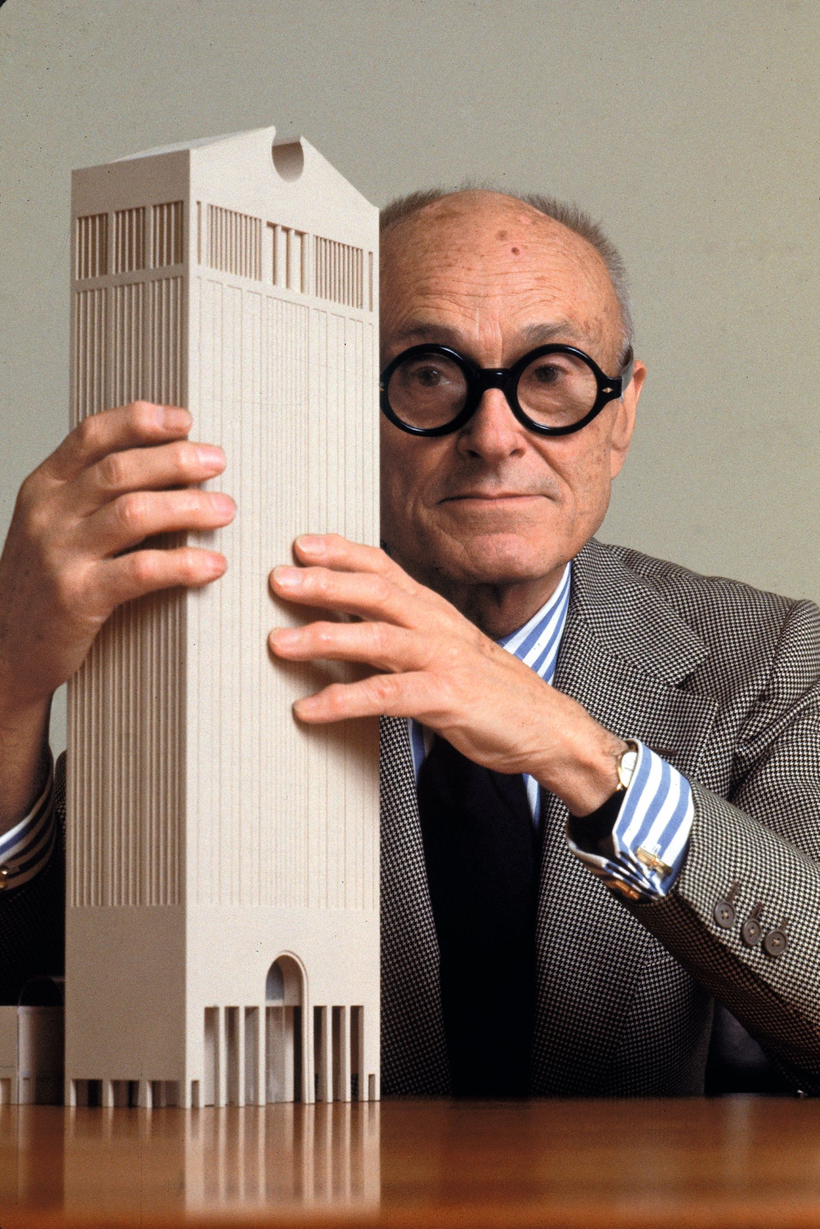 Philip Johnson posing with a model of his newly designed AT&T Building, May 1978