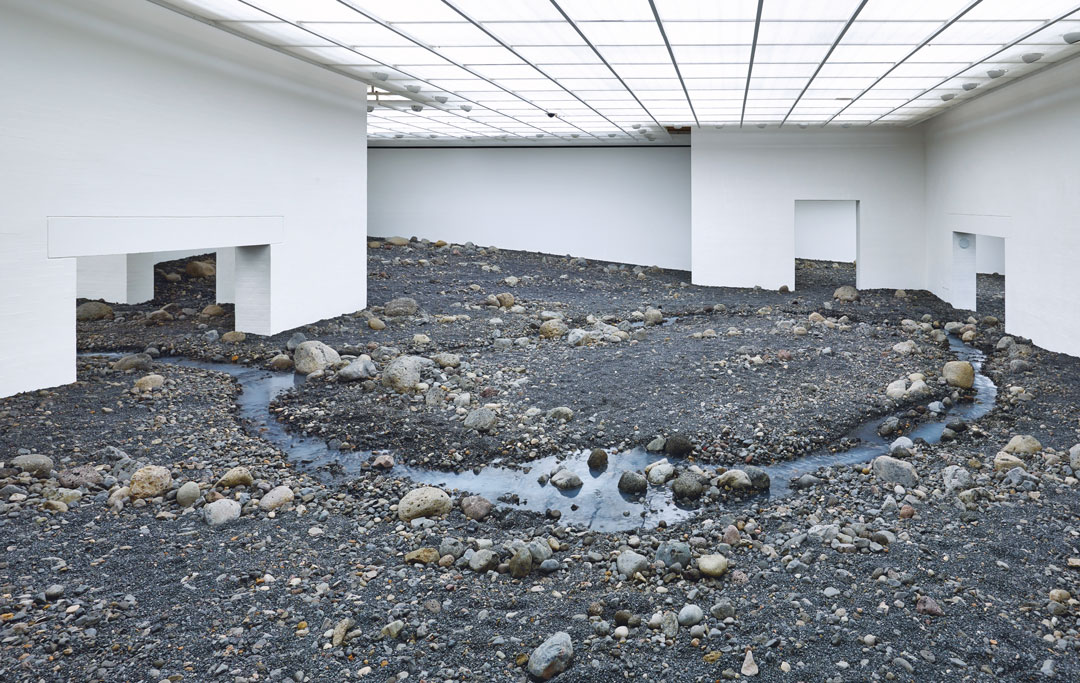 Riverbed, 2014, water, Icelandic rock (volcanic stones [blue basalt, basalt, lava], other stones, gravel, sand), wood, steel, plastic sheeting, hose, pumps, cooling unit, dimensions variable, installation views at Louisiana Museum of Modern, Art, Humlebæk, Denmark, 2014. Picture credit: Anders Sune Berg