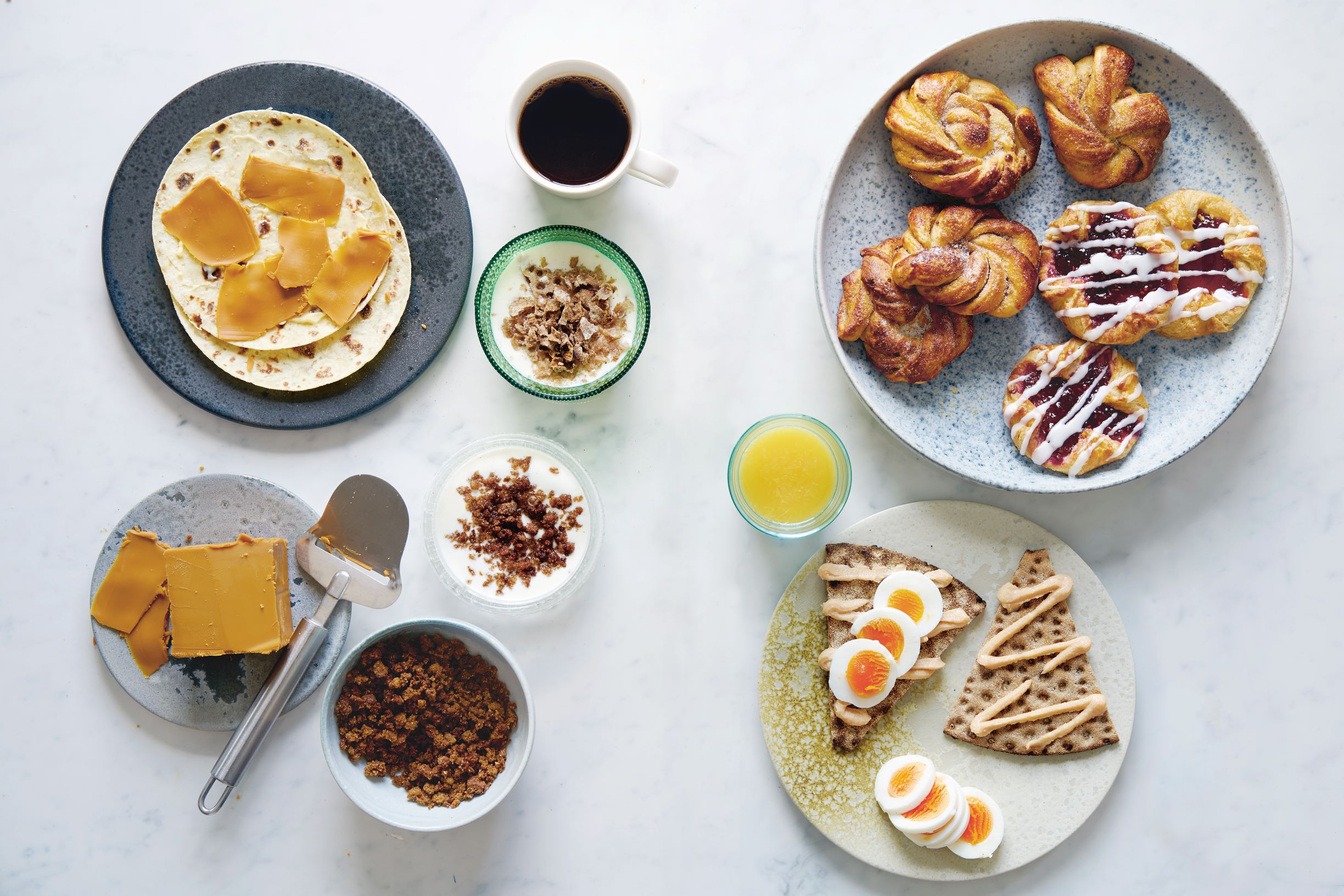 Clockwise from top left: Brown cheese sandwich; filmjölk; Danish pastry; cardamom buns; crispbread with smoked cod roe spread; ymerdrys; ymer with ymerdrys; all from the Nordic pages of Breakfast: The Cookbook