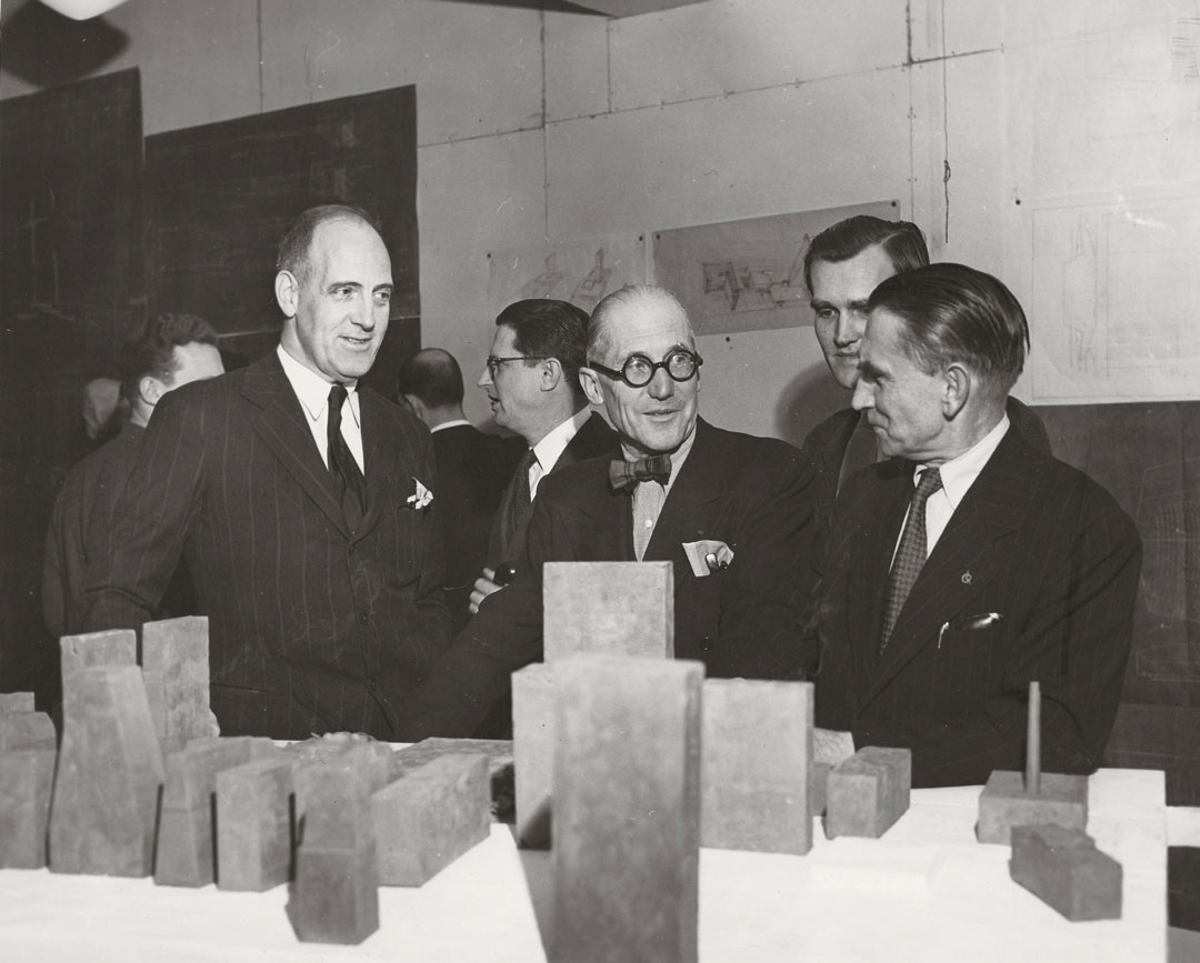 Le Corbusier, standing behind a display of models for the UN complex with Wallace K. Harrison (left) and Vladimir Bodiansky (right), 1947. Picture credit: courtesy Fondation Le Corbusier, Paris. As reproduced in Le Corbusier Le Grand