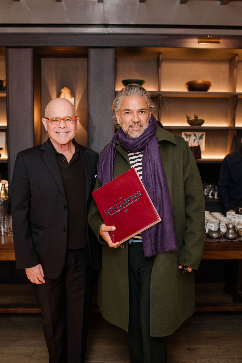Phaidon's William Norwich with interior designer Carlos Mota at the launch for Interiors: The Greatest Rooms of the Century at Roman and Williams Guild New York