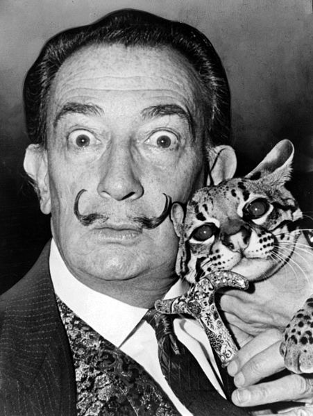Salvador Dalí with his pet ocelot, Babou, 1965