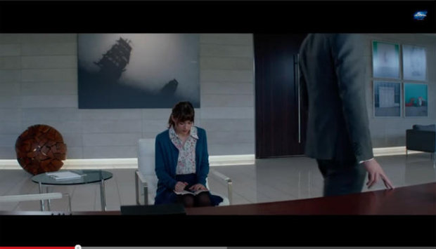 A screengrab from the new 50 Shades of Grey trailer, which appears to feature an Ed Ruscha painting in the background