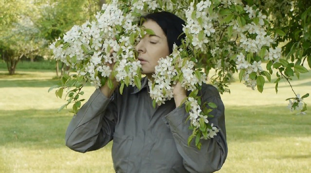 Marina demonstrates exercises in nature (still from a film by Noah Blumenson-Cook)