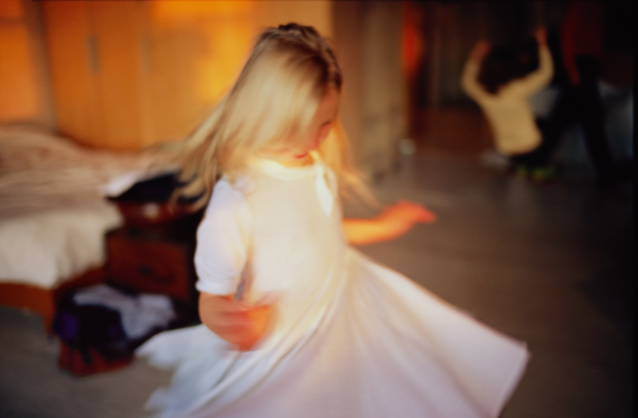 Ava twirling, NYC, 2007, by Nan Goldin, from Eden and After